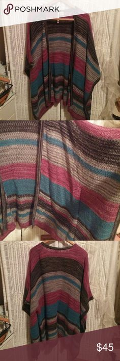 Poncho Sweater Awesome multi color ponch sweater. Drapes real nice when worn. Size Med but could fit a large since its open. Its sewn down the sides to slip your arms thru. Very comfy!! Leo and Nicole Sweaters