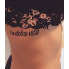 "Little side tattoo saying ""La dolce vita"", Italian for ""the good life"" on Ashley Appel."