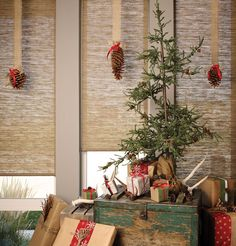 Infuse a natural warmth into holiday decor with Hunter Douglas Alustra® Woven Textures® roller shades. #WindowTreatments #holiday #interiordesign #HunterDouglas #christmas