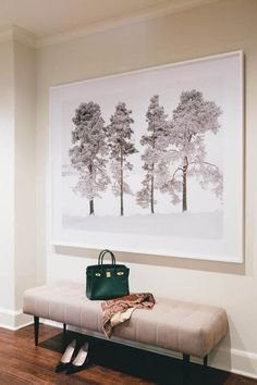 Oversized art with bench in the hallway by interior designer Jean Liu (via Desire to Inspire).