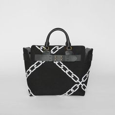 229964b80bf7 A belted tote influenced by our iconic trench