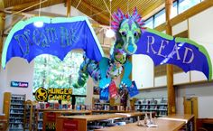 Drusilla the dream dragon.  Each kid who signed up for summer reading decorated a dragon scale and  Library staff voted on her name.