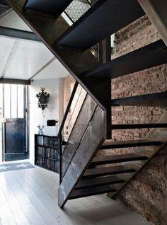 exposed brick + wood stairs