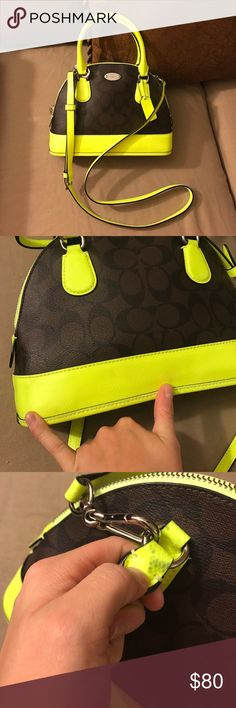 Neon coach Small dome bag My fingers are pointing at the two light color transfer marks on the back of the bag. And where the metal has darkened the neon on the handle on the back underneath it. None of the color marks can be seen worn. Awesome bag! Love this so much. Silver hardware and comes with strap. Coach Bags Crossbody Bags