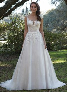 Soft details including an illusion Sabrina neckline, beaded lace appliques, Chantilly lace underlay, illusion back, and chapel length train create this wedding day look. https://www.sweetheartgowns.com/sweetheart/6166