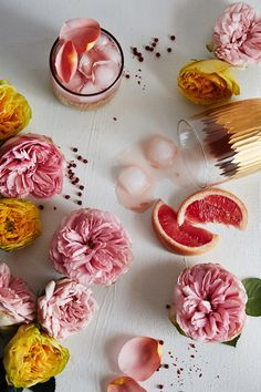 A rose-infused vodka and grapefruit cocktail, garnished with fresh rose petals, now on the #AnthroBlog #recipe #cocktail