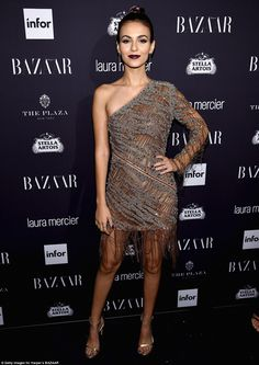 Chic: Victoria Justice wore a fringed sheer one-shoulder frock with gold heels and dark lipstick