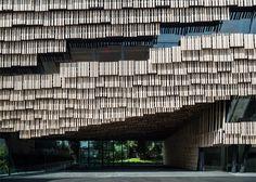 Kengo Kuma creates facade of wooden strips for university