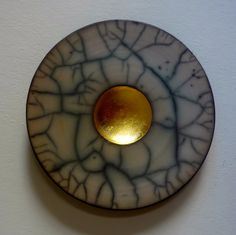 Emma Johnstone. Umber slip with gold leaf. 30cm wall piece