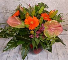 Orange, green and purple autumn styled flowers in a customers black and orange vase. Surrey, Green And Purple, Corporate Events, Vase, Autumn, Seasons, Orange, Flowers, Plants