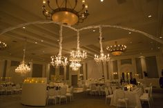 Luxe Chandelier Wedding at Four Seasons Las Vegas.  C Chairs and Chandeliers at Luxury Wedding Four Seasons.    White and grey wedding produces by award winning Las Vegas wedding planner Andrea Eppolito.  Las Vegas Wedding Planner Andrea Eppolito.  Photo by AltF Photography.  Decor by DBD Weddings