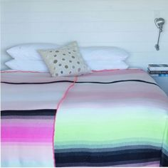 Neon blanket...saw this in a shop window the other morning...need it for my guest room! or a summer swap out!