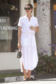 Lily Aldridge wearing Jenni Kayne Mule Slides in Black Lambskin Leather and Reformation Ghana Dress in Eco Riviera