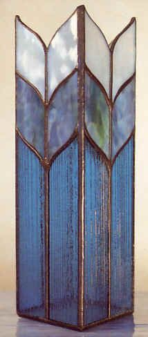 Simple yet beautiful vase or candle shade. I believe the textured blue glass around the bottom is a 90 COE produced by Uroboros Glass Co. Stained Glass Lamp Shades, Stained Glass Light, Stained Glass Ornaments, Making Stained Glass, Stained Glass Designs, Stained Glass Projects, Stained Glass Patterns, Stained Glass Windows, Mosaic Patterns