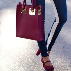 a burgundy bag adds the perfect pop to a fall look