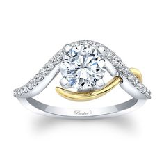 This yellow and white gold engagement ring features a round center diamond. The white gold shank is adorned with diamond melee, a yellow gold accent ridge springs out of the shank on one side and swings up to cradle the center for a dramatic flare. Two Tone Engagement Rings, Designer Engagement Rings, Solitare Ring, Dream Ring, Beautiful Earrings, Colored Diamonds, Diamond Jewelry, Prong Set, White Gold