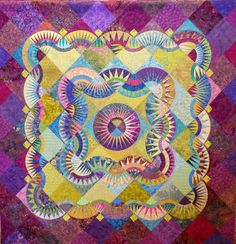 Evening Star Quilt Guild's 2013 raffle quilt, posted at Nonnie's Quilting Dreams.  New York Beauty blocks.