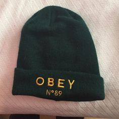 b1d75a0265e Cute and trendy green obey beanie Green beanie with obey gold lettering on  the front.