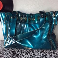Big Metallic Blue Zipper purse Used several of times.  Wear through purse from creasing as seen in pic four.  Inside is still in great shape.  In overall good condition.   11 Jessica Simpson Bags