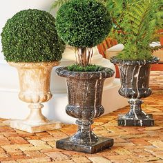 Create a regal entryway or an elegant back patio by simply adding decorative planters. In two classic colors, each is ornately sculpted with a bold, fluted pedestal base.