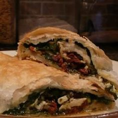 Cooks who love intensely flavored ingredients of Mediterranean cuisine--garlic, basil, sun-dried tomatoes, feta cheese--will enjoy these savory chicken breasts wrapped with flaky puff pastry.