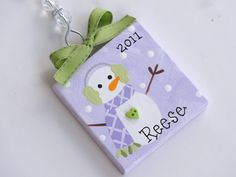 3x3 mini canvas Christmas ornaments. Hand Painted, embellished and personalized just for you! You can choose colors, design and personalization. I can use any color background you prefer. Please let me know if you would like something completely unique. I love to add mini buttons, rhinestones, glitter, etc. Please send personalization information in the notes to seller box of your order/payment. If you would like one of the designs shown, please include a brief description. Im happy to…