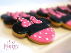Decorated cookies at a Minnie Mouse birthday party! See more party planning ideas at CatchMyParty.com!