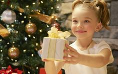 Child giving a Christmas present near christmas tree hd wallpaper Christmas Pictures, Family Christmas, Christmas Presents, Holiday Gifts, Christmas Holidays, Christmas Ornaments, Xmas Pics, Merry Christmas, Christmas Ideas