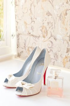 White Christian Louboutin shoes