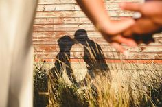 Out of focus close-up of hands and shadow on wall and tall grasses ~ we ❤ this! moncheribridals.com