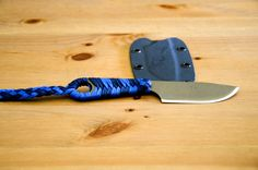 """An Ardent Knives """"Shrike SE"""" with a Burnt Bronze Cerakote coated blade and Navy Blue and Royal Blue paracord handle wrap. Custom Kydex sheath included. www.ardentknives.com"""