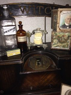 Great display of apothecary and medicine bottles. Love the way the old Zenith radio has become a shelf to display these items as well as some 1800 cigar boxes and a neat dental oddity. Very steampunk looking to me:)