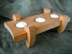 Triple wooden tea light candle holder on Etsy, $15.00