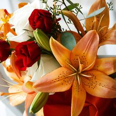 Deep red and vibrant orange make a bold wedding color scheme. See 17 more fabulous color combinations: http://www.bhg.com/wedding/color/perfect-wedding-color-combos/?socsrc=bhgpin080812redorangebouquet#page=8