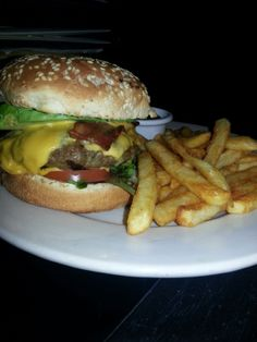 B52 BURGER $10 1/3lb Burger Topped with Cheddar, Bacon & Avocado with Side O' French Fries