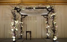 This dark wooden chuppah frame accented with cherry blossoms and hydrangea was the perfect spring premiere!