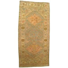 Antique N.W. Persia Decorative Oriental Carpet, Small Runner Size in Soft Colors | From a unique collection of antique and modern persian rugs at https://www.1stdibs.com/furniture/rugs-carpets/persian-rugs/