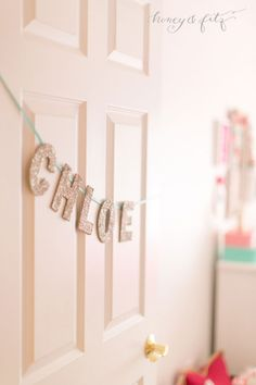 Glitter letter name garland on the door.