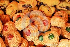 Red and green almond Sicilian pastry background.