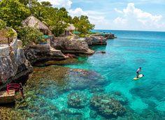 Rockhouse Hotel Caribbean water sky outdoor rock landform Sea body of water Nature vacation Ocean Coast bay tropics Lagoon terrain Island