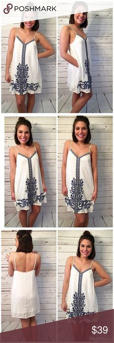White fully lined embroidered pocket dress! Love this piece with adjustable straps fully lined - length is 34- with pockets- 100% Rayon stunning blue embroidery Dresses