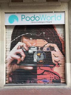 Taking photo - painted store shutters - Barcelona