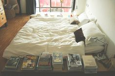 A perfect bedroom must have a big bed on the floor, a lamp, and books within reach.