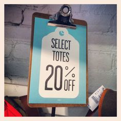 Clip boards used as simple store signage- easy to print, easy to change.