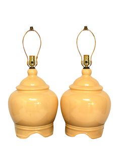 A sweet pair of vintage ginger jar style lamps.Ceramic construction with a clean cream finish. In excellent condition and ready grace your home.
