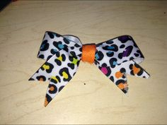 Leopard goes great with rainbow and orange! Go animal print! This is a product from Ruthi's new mini bow line of products!