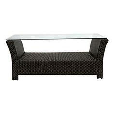 """Indoor/outdoor coffee table with a glass top and woven base.   Product: Coffee tableConstruction Material: Polyethelene, powder coated aluminum and glassColor: BlackDimensions: 18"""" H x 44"""" W x 24"""" DCleaning and Care: Clean frame with mild detergent and water. Use glass cleaner for table top."""