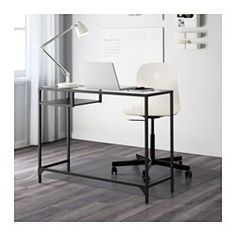 IKEA - VITTSJÖ, Laptop table, , Made of tempered glass and steel, durable materials that give an open, airy feel.The shelf is black-brown on one side and black on the other, so you can choose the expression you like the best.Table with work surface and storage inside for a laptop turns any small space into a functional work space.Self-adhesive cable clips keep your cords in place and out of sight.Adjustable feet allow you to level the table on uneven floors.