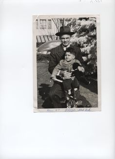My dad, Jake W. Nigro, and me (Fred) in the park on my tricycle. He was a good dad, but very strict. He and my mom made a great couple and we had a good home life.