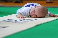 A HAPPY COMPETITOR: A baby competed in a crawling race in Moscow's Sokolniki Park on Monday. (ITAR-Tass/Zuma Press)